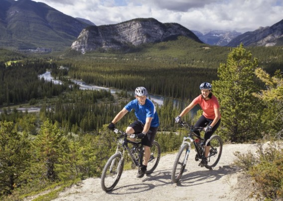 Couple Mountain Biking on Tunnel Mountain